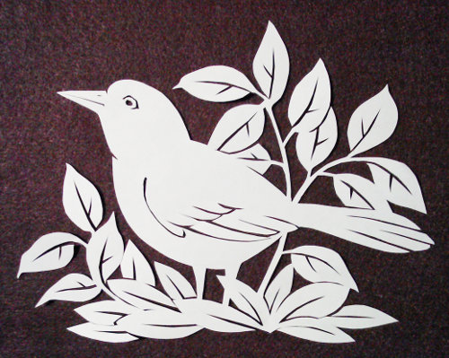 cut paper ornate design Alert Bird